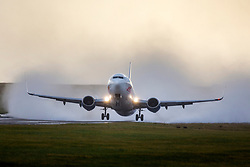 © Licensed to London News Pictures. 08/12/2019. Leeds UK. An aircraft takes off in heavy rain from Leeds Bradford airport as Storm Atiyah continues to batter the UK. Photo credit: Andrew McCaren/LNP