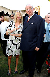 The HON.FLORA HESKETH and MR HENRY KESWICK at a Conservative Party summer garden party hosted by Lord Hesketh and held at 7 Lansdowne Road, Notting Hill, London W11 on 28th June 2004.