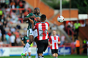 Paul-Arnold Garita (26) of Plymouth Argyle leaps above Luke Croll (29) of Exeter City to head the ball during the EFL Sky Bet League 2 match between Exeter City and Plymouth Argyle at St James' Park, Exeter, England on 17 September 2016. Photo by Graham Hunt.