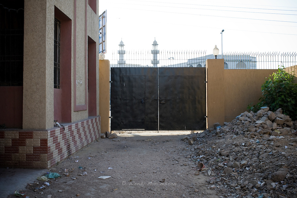 The backside of the gate of the Women's police station, closed off most of the time. <br /> Women&rsquo;s police stations were founded from 1994 onwards by then Prime Minister Benazir Bhutto. <br /> Initially set up to investigate cases of violence against women and have them handled by female police officers, the reality on the ground is often very different. With limited authority and hardly any female police officers on duty, they don't fully serve the purpose they were intended for. Karachi, Pakistan, 2011