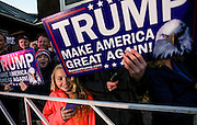The crowd catches sight of Republican presidential candidate Donald Trump as arrives for a town hall meeting at Atkinson Country Club in Atkinson, N.H., Monday, Oct. 26, 2015.  (AP Photo/Cheryl Senter)