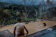 "The ""rotenburo"" outdoor bath at the Tokachidake Onsen (Mt. Tokachi Hot Spring) on a cold autumn day.  Daisetsuzan National Park, Hokkaido, Japan"