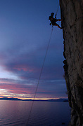 NV-SAS68..Climber Jobe Pilgrim, a life-long resident of South Lake Tahoe, climbs up a rock wall just north of South Lake Tahoe, NV, Monday evening May 12, 2003.