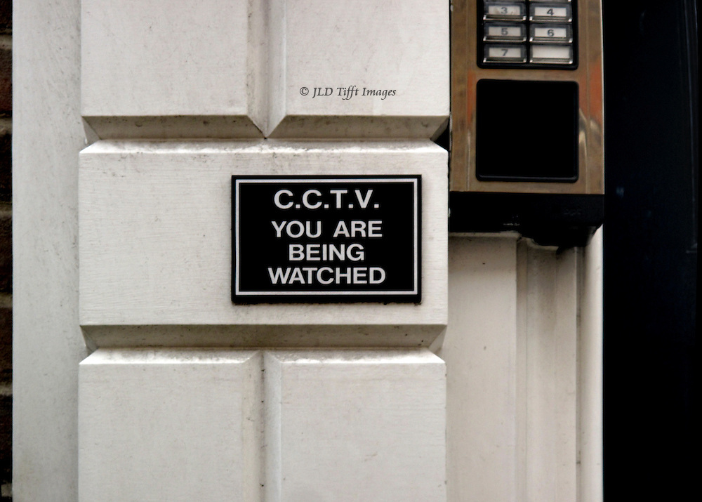 "Sign at the entrace of a refurbished office building in the City, London.  ""C.C.T.V.YOU ARE BEING WATCHED."""