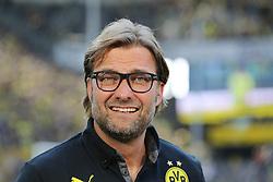 28.09.2013, Signal Iduna Park, Dortmund, GER, 1. FBL, Borussia Dortmund vs SC Freiburg, 7. Runde, im Bild Trainer Juergen Klopp (Borussia Dortmund) nachdenklich, konzentriert, fokussiert, lacht, lachend // during the German Bundesliga 7th round match between Borussia Dortmund and SC Freiburg at the Signal Iduna Park, Dortmund, Germany on 2013/09/28. EXPA Pictures © 2013, PhotoCredit: EXPA/ Eibner/ Joerg Schueler<br /> <br /> ***** ATTENTION - OUT OF GER *****