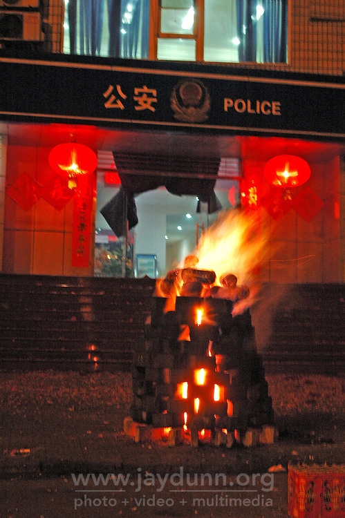 China, Taiyuan, 2008. Even the police join in celebrating Chinese New Year in style. This bonfire, made of Shanxi's plentiful coal bricks, will burn for days.
