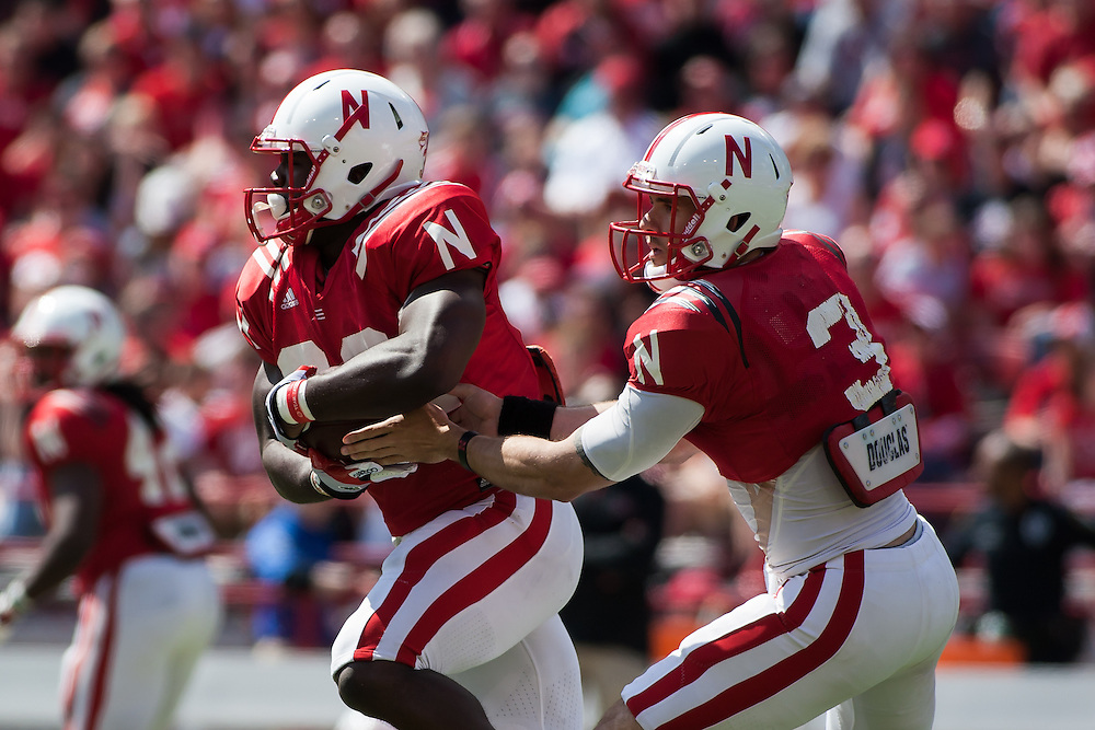 April 06, 2013: Quarterback Taylor Martinez with the read option handing off the ball to Imani Cross #32 during the Red-White spring game at Memorial Stadium in Lincoln, Nebraska. The Red team defeated the White team 30 to 21.
