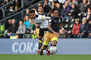 Derby County midfielder Duane Holmes challenges Sheffield Wednesday midfielder Rolando Aarons during the EFL Sky Bet Championship match between Derby County and Sheffield Wednesday at the Pride Park, Derby, England on 9 March 2019.
