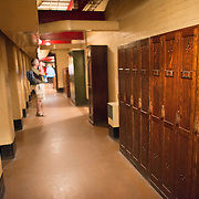 One of the cramped corridors at the Churchill War Rooms in London. The museum, one of five branches of the Imerial War Museums, preserves the World War II underground command bunker used by British Prime Minister Winston Churchill. Its cramped quarters were constructed from a converting a storage basement in the Treasury Building in Whitehall, London. Being underground, and under an unusually sturdy building, the Cabinet War Rooms were afforded some protection from the bombs falling above during the Blitz.