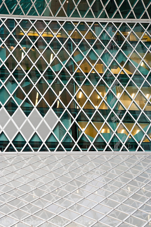 A wall of diamond shaped-windoes at the Seattle Central Public Library in downtown Seattle, Washington, USA