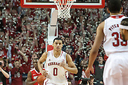 January 20, 2014: Tai Webster (0) of the Nebraska Cornhuskers makes the first basket for the Huskers against Ohio State Buckeyes at the Pinnacle Bank Arena, Lincoln, NE. Nebraska won in the game against Ohio State 68 to 62.