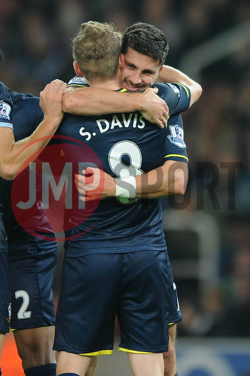Southampton's Shane Long celebrates his goal with Southampton's Steven Davis who set him up for the goal - Photo mandatory by-line: Dougie Allward/JMP - Mobile: 07966 386802 - 29/10/2014 - SPORT - Football - Stoke - Britannia Stadium - Stoke City v Southampton - Capital One Cup - Fourth Round