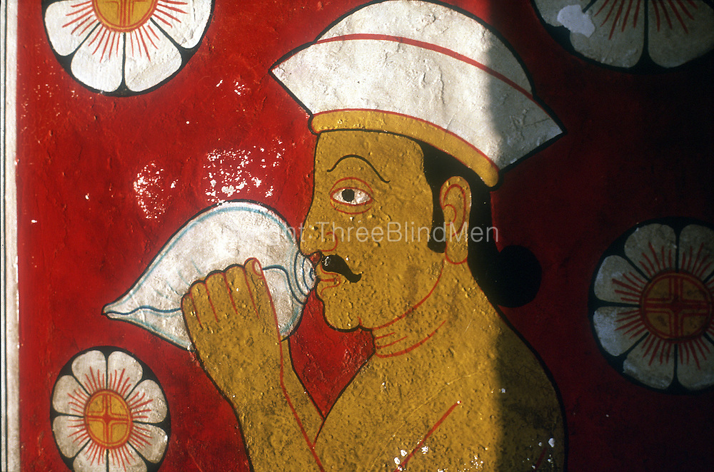 Painting in the short tunnel entrance to the Temple of the Tooth (Dalada Maligawa) in Kandy. This image is the 'original', prior to changes made after the bomb blast in 1998..Copyright: Dominic Sansoni