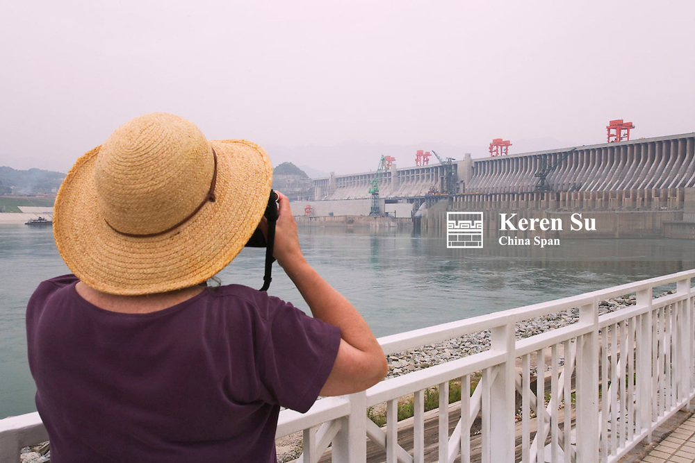 Tourist photographing Three Gorges Dam construction site, Zigui, Hubei, China