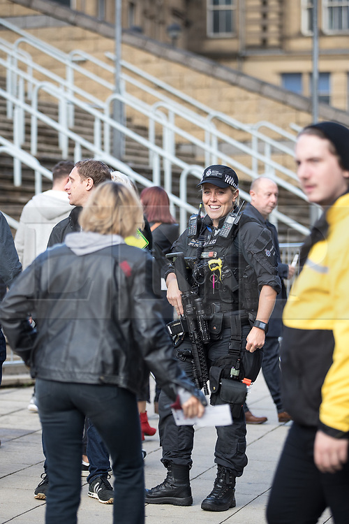 © Licensed to London News Pictures . 09/09/2017. Manchester , UK . Armed police patrolling on Hunts Bank , outside the venue . We Are Manchester reopening charity concert at the Manchester Arena with performances by Manchester artists including  Noel Gallagher , Courteeners , Blossoms and the poet Tony Walsh . The Arena has been closed since 22nd May 2017 , after Salman Abedi's terrorist attack at an Ariana Grande concert killed 22 and injured 250 . Money raised will go towards the victims of the bombing . Photo credit: Joel Goodman/LNP