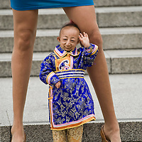London Sep 16 Trafalgar Square, London, WC2. The world's shortest living man - 20-year-old He Pingping from China - poses with Svetlana Pankratova from Russia, who has the longest legs of any woman in the world to publicise tomorrow's launch of new Guinness Book Of World Records - see separate entry. Pankratova's pins measure in at 132cms in length, almost twice the height of Pingping.
