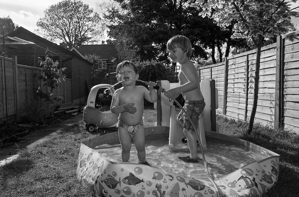 Ben gives Joe a drink of water from the hose as they play in their paddling pool in our back yard at home in Berkhamsted, England Tuesday, June 16, 2015 (Elizabeth Dalziel) #thesecretlifeofmothers #bringinguptheboys #dailylife