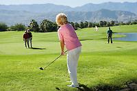 Group senior golfers on golf course