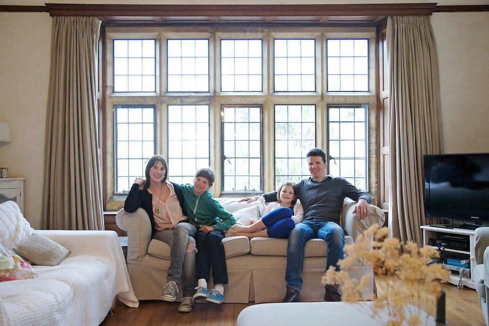 The Baker family in their living room. From left to right: Susannah Baker, Zac Baker (11), Liza Baker (9), Steve Baker. Pickwell Manor, Georgeham, North Devon, UK.<br /> CREDIT: Vanessa Berberian for The Wall Street Journal<br /> HOUSESHARE