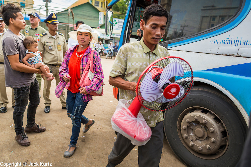 16 JUNE 2014 - POIPET, CAMBODIA:  Cambodian migrants arrive in Poipet, Cambodia, after fleeing Thailand Monday. More than 150,000 Cambodian migrant workers and their families have left Thailand since June 12. The exodus started when rumors circulated in the Cambodian migrant community that the Thai junta was going to crack down on undocumented workers. About 40,000 Cambodians were expected to return to Cambodia today. The mass exodus has stressed resources on both sides of the Thai/Cambodian border. The Cambodian town of Poipet has been over run with returning migrants. On the Thai side, in Aranyaprathet, the bus and train station has been flooded with Cambodians taking all of their possessions back to Cambodia.   PHOTO BY JACK KURTZ