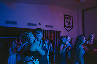 Olivia Salm shares a secret with her boyfriend Mitchel Jensen during the homecoming dance, which took place in the school's cafeteria.
