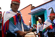 Indigenous people march through Oaxaca streets, staging an Alternativ Geulegetza, in 2006 in support of APPO.