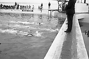 Gallagher High Diving Gala.<br /> 1966.<br /> 01.07.1966.<br /> 07.01.1966.<br /> 1st July 1966.<br /> The Gallagher Sponsored High Diving Gala was held today at The Blackrock Swimming Bath. Sandycove Swimming Club were the holders of the event. <br /> Image shows Mr D.O'Dea.Colmcille S C,winning the Mens' 100 Metres Freestyle Challenge race at the baths setting a new record of 59.4seconds.