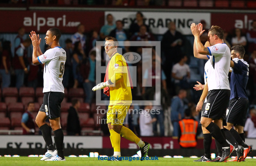 Picture by John Rainford/Focus Images Ltd +44 7506 538356<br /> 27/08/2013<br /> Cheltenham Town players applaud the travelling support after the Capital One Cup match at the Boleyn Ground, London.