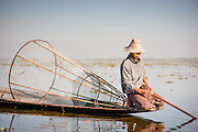 Young fisherman on boat on Inle Lake