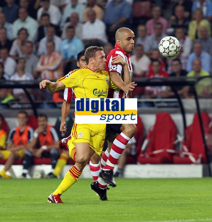 Photo: Chris Ratcliffe.<br /> PSV Eindhoven v Liverpool. UEFA Champions League, Group C. 12/09/2006.<br /> Craig Bellamy of Liverpool clashes with Alex of PSV Eindhoven.