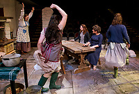 The Mundy sisters begin to dance as music from their radio turns back on during dress rehearsal for Dancing at Lughnasa with the Winnipesaukee Playhouse on Tuesday.  (l-r) Margaret Lundberg (Agnes Mundy), Nerrishia Bodwell (Rose Mundy), Delaney Andrews (Christina Mundy), Doreen Fotino Sheppard (Kate Mundy) and Tamara McGonagle (Maggie Mundy).   (Karen Bobotas/for the Laconia Daily Sun)