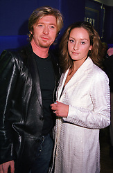 Top hairdresser NICKY CLARKE and MISS OCTAVIA COATES, at a film premier party in London on 14th November 2000.OJB 55