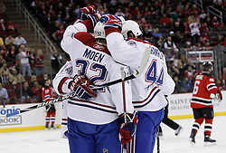 Dec 16, 2009; Newark, NJ, USA; The Montreal Canadiens celebrate a goal by Montreal Canadiens left wing Travis Moen (32) during the first period at the Prudential Center.