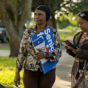 NORTH MIANI, FLORIDA, NOVEMBER 8, 2016<br /> Move On volunteers Lorna Shuford and her mother Delma Rodriguez  knock on doors of homes of voters in the North Miami area as they canvass for democratic votes.<br /> (Photo by Angel Valentin/Freelance)