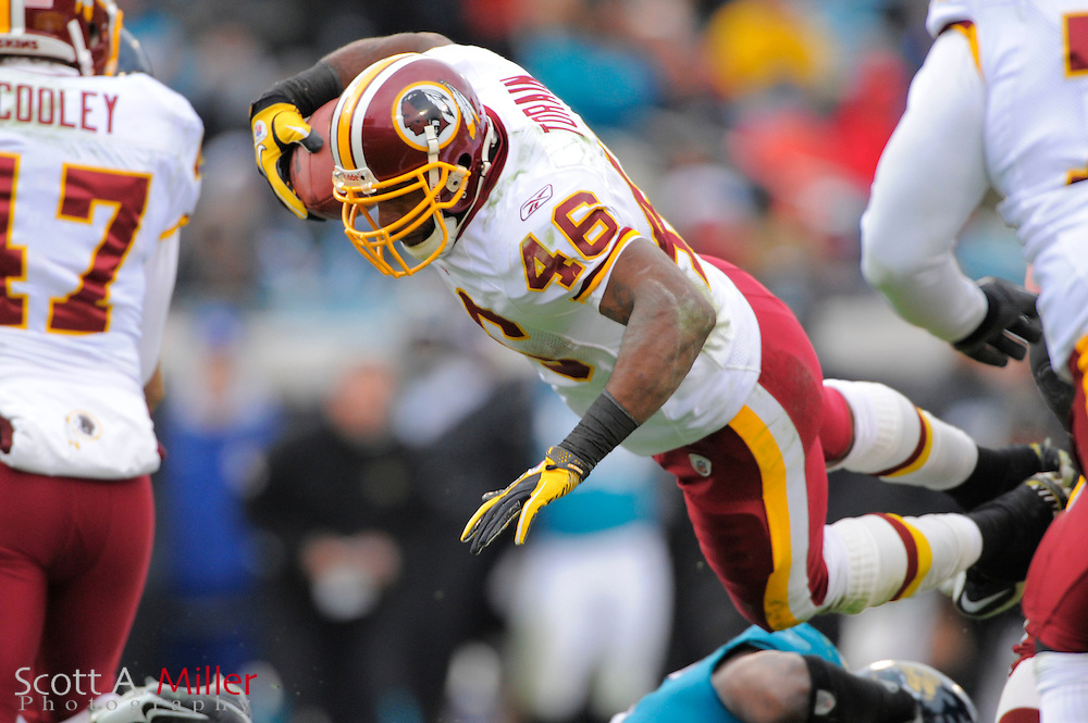 Washington Redskins running back Ryan Torain (46) dives through the air during the Redskins 20-17 overtime win over the Jacksonville Jaguars at EverBank Field on Dec. 26, 2010 in Jacksonville, Fl. © 2010 Scott A. Miller