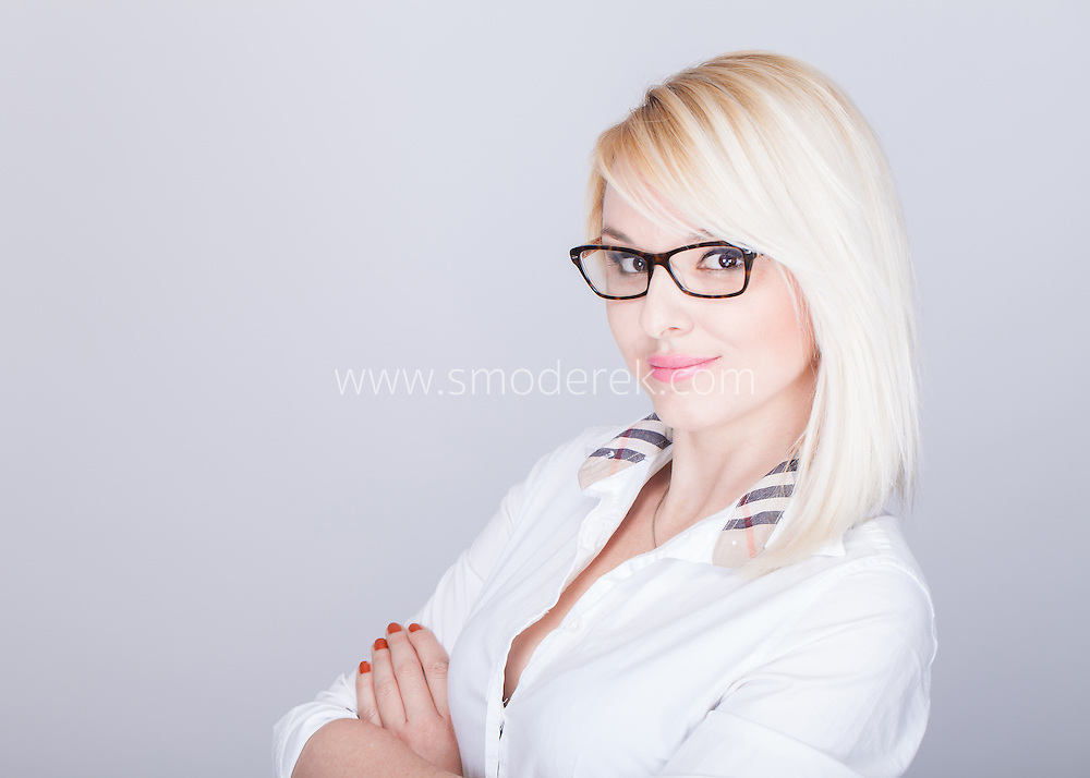 Young attractive woman in nerd glasses and button down shirt High end corporate photography by a Los Angeles based photographer Karol Smoderek