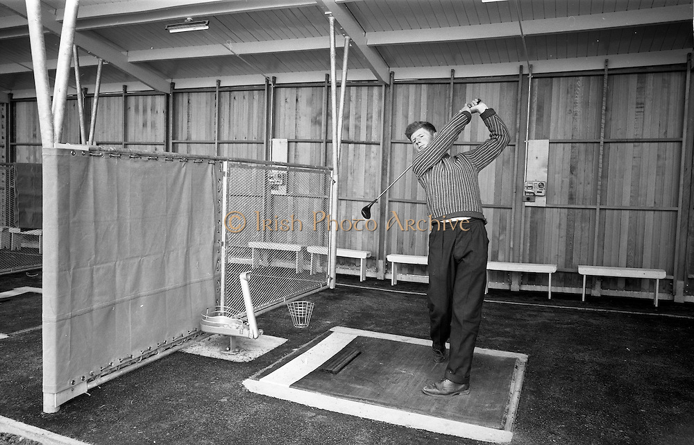 14/05/1965<br /> 05/14/1965<br /> 14 May 1965<br /> New Golf Range at Leopardstown, Foxrock, Dublin. Image shows a golfer practicing his driving at the range.