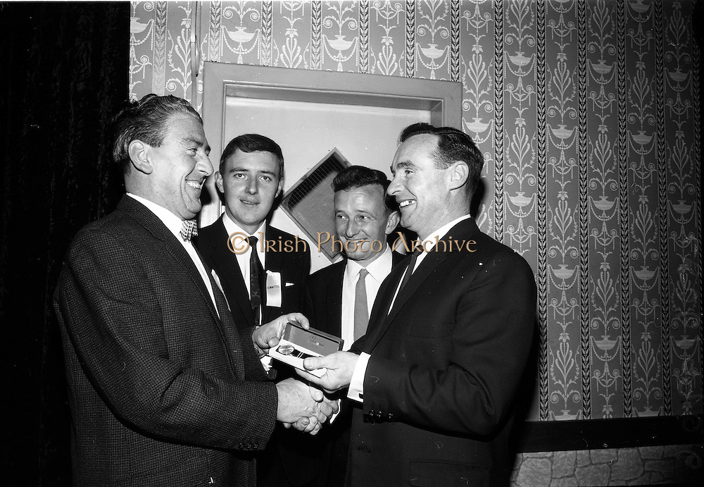 06/05/1965<br /> 05/06/1965<br /> 06 May 1965<br /> Soccer Writers Award presented at the Maples' Hotel, Dublin. Picture shows Mr Eddie Boyle, (left) President of the Soccer Writers Association presenting the Soccer Writers Annual Award to Mr Sean Thomas (right), Coach of Bohemians at the Annual Dinner of the Association. In centre are Mr Bill O'Herlihy (2nd from left) of the Cork Examiner and Mr Derek Jones, Hon. Sec. of the Association.