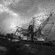 "Louisiana fisherman are suffering as large areas have been closed to commercial fishing because of the the growing oil spill in the Gulf of Mexico. This depression in economic livelihood is illustrated here by a shrimping boat, seen through raindrops on a window and under stormy skies in Galliano, Louisiana. The U.S. Gulf coast accounts for about 20 percent of the nation's total commercial seafood production. The shrimp and oyster supply, in particular, is very concentrated in the Gulf. ltqmb ""Stormy Horizons"""