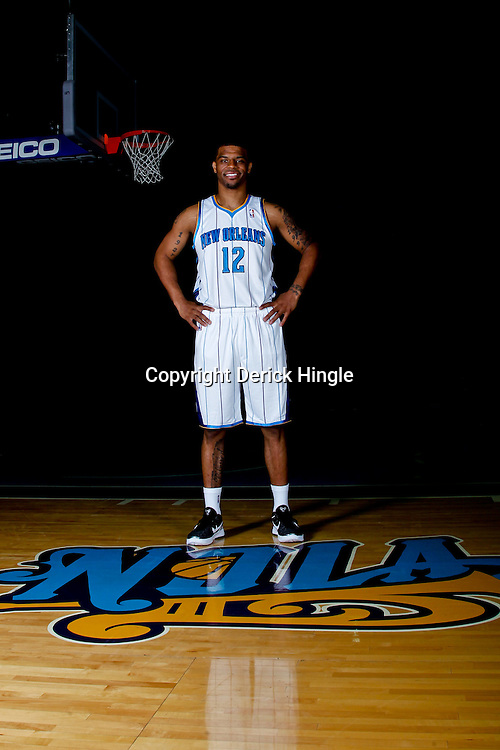 December 14, 2011; New Orleans, LA, USA; New Orleans Hornets guard Trey Johnson (12) poses for a photo during Media Day at the New Orleans Arena.   Mandatory Credit: Derick E. Hingle-US PRESSWIRE
