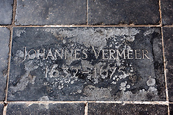 Floor plaque indicating  resting place of artist Johannes Vermeer in Oude Kerk, Delft, The Netherlands