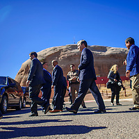 FBI Director Christopher Wray walks to his motorcade ahead of Navajo Nation President Russell Begayeat the Office of the President and Vice President in Window Rock Friday.