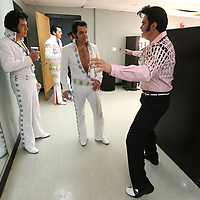 Elvis Tribute Artists Travis Albertson, David Allen and Michael Cullipher pass the time in the dressing room after getting ready for their round one performances in the Ultmate Elvis Tribute Artist Competition at the BancorpSouth Arena on Friday morning.