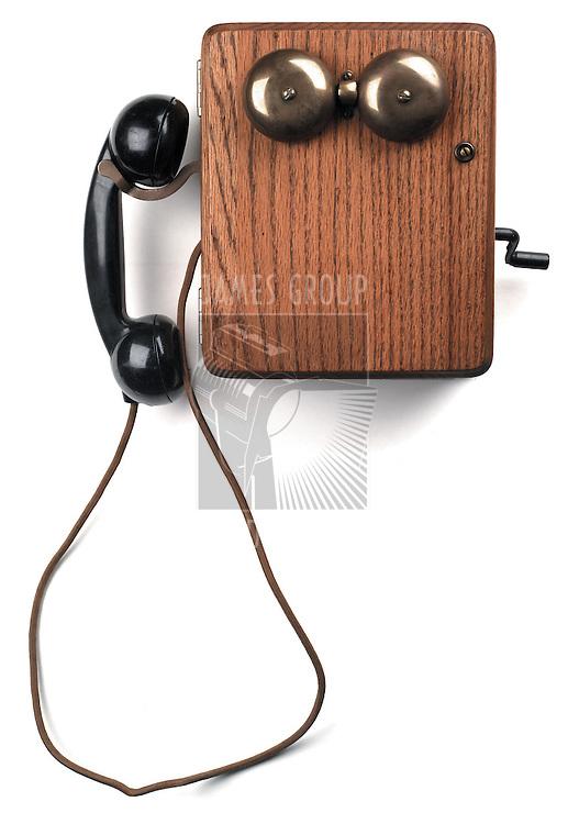 antique crank telephone on white