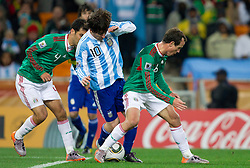 Rafael Marquez (4) of Mexico and Gerardo Torrado (6) of Mexico vs Lionel Messi of Argentina during the 2010 FIFA World Cup South Africa Round of Sixteen match between Argentina and Mexico at Soccer City Stadium on June 27, 2010 in Johannesburg, South Africa. (Photo by Vid Ponikvar / Sportida)