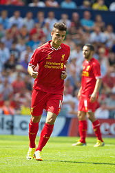PRESTON, ENGLAND - Saturday, July 13, 2013: Liverpool's Philippe Coutinho Correia celebrates scoring the first goal against Preston North End during a preseason friendly match at Deepdale. (Pic by David Rawcliffe/Propaganda)