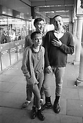 Sharon, Danny and friend outside Woolworths, High Wycombe, UK, 1980s