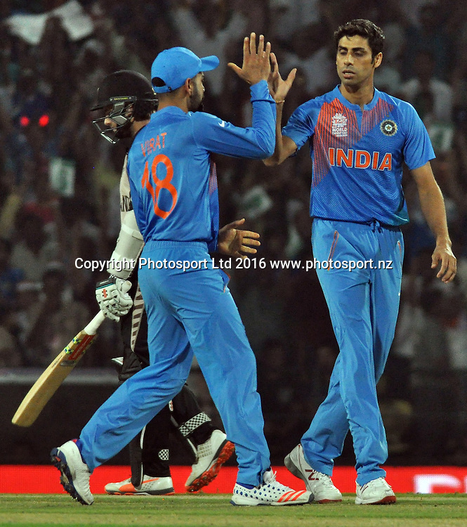 Indian bowler Ashish Nehra celebrates New Zealand batsman Colin Munro wicket (c) by Hardik Pandya during the India vs New Zealand ICC World T20 match at the Vidarbha Cricket Association (VCA) Stadium in Nagpur, India on March 15, 2016 , Photo by - Nitin LawateIndia on March 15, 2016 , Photo by - Nitin Lawate