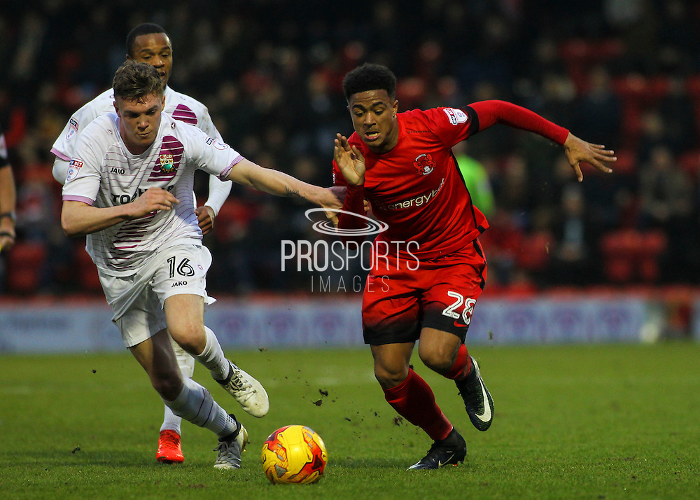 Josh Koroma breaks away from Harry Taylor during the EFL Sky Bet League 2 match between Leyton Orient and Barnet at the Matchroom Stadium, London, England on 7 January 2017. Photo by Jack Beard.