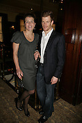 Amber Nuttall  and Tom Aikens, PJ's Annual Polo Party . Annual Pre-Polo party that celebrates the start of the 2007 Polo season.  PJ's Bar & Grill, 52 Fulham Road, London, SW3. 14 May 2007. <br />